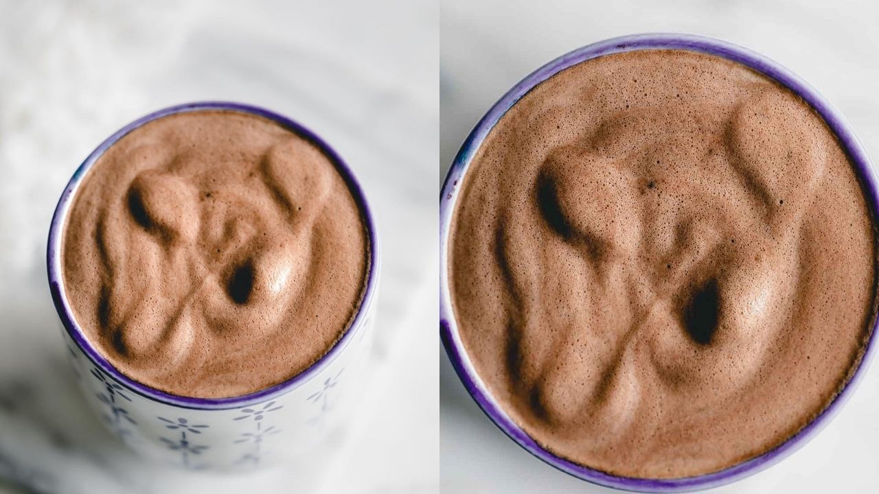 Frothed vegan chocolate milk in a blue and white mug on a marble backdrop